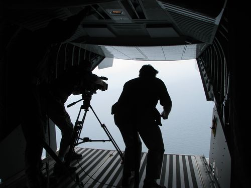 Reporters on the cargo bay of a Coast Guard plane during a fly-over mission of the Gulf of Mexico oil spill. I was up next.